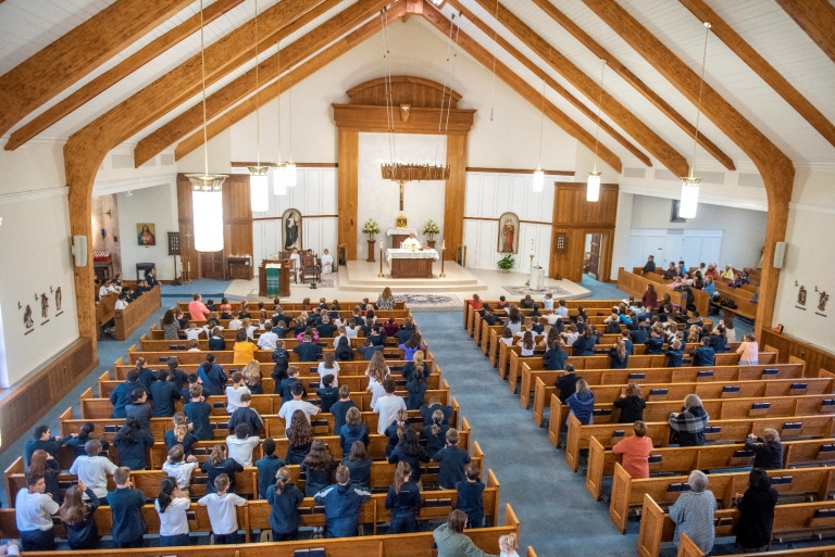 View from the choir loft of the school body seated at Mass in the church