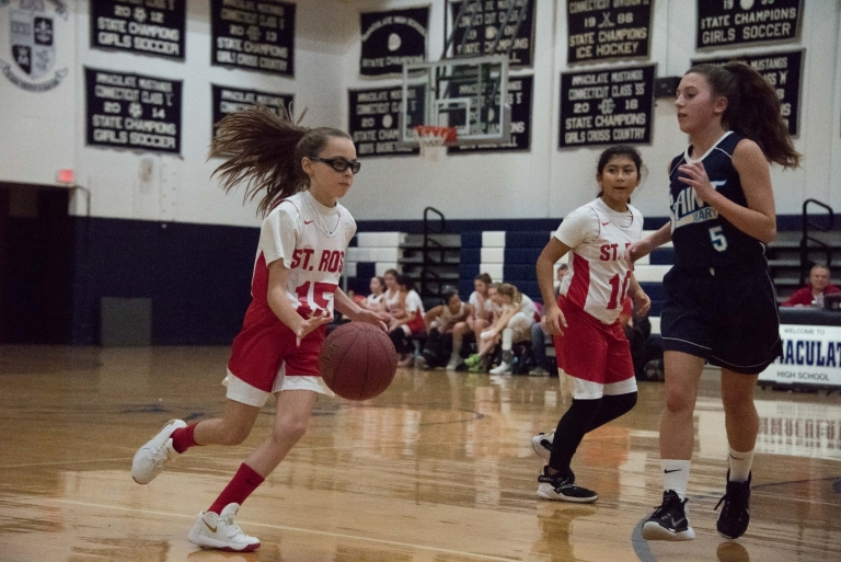 Athletes in Motion in a Girls Basketball Game