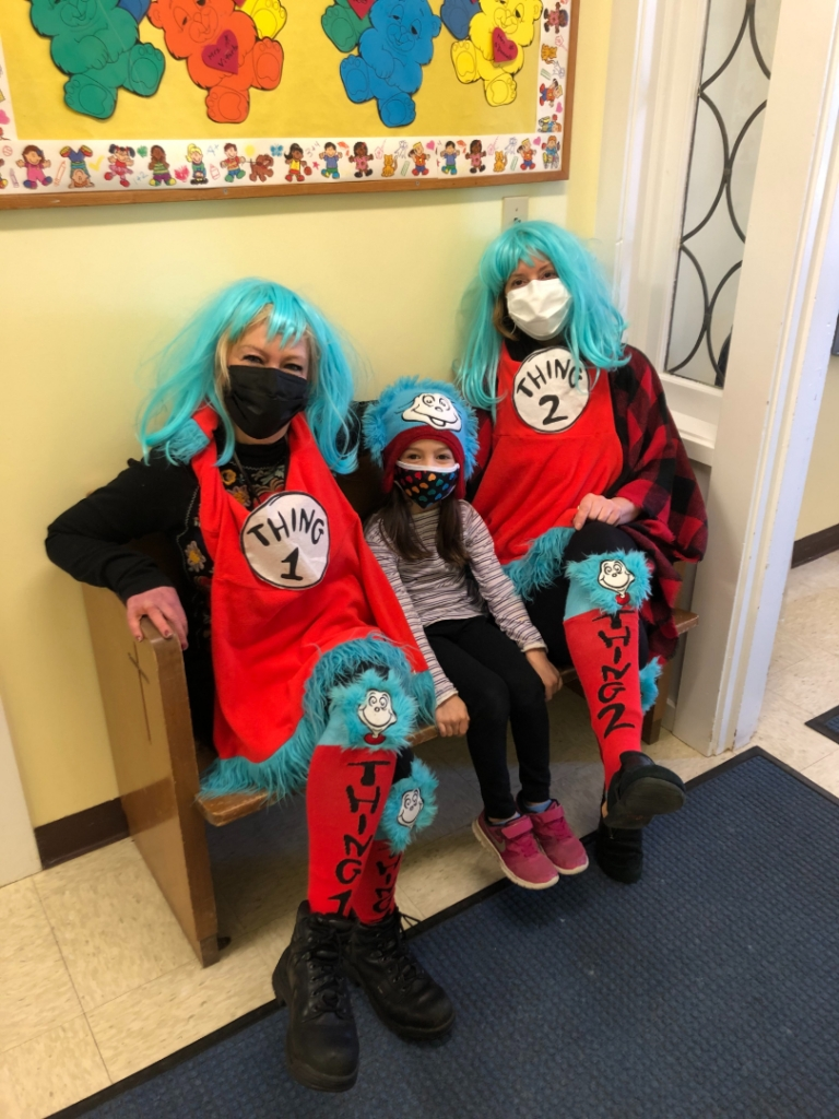 Preschool teachers in Thing 1 and Thing 2 costumes with student